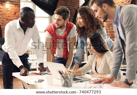 Group of five creative worker brainstorm together in office, new style of workspace, happy scene of people in office.