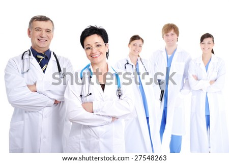 group of five happy smiling cheerful doctors in hospital gowns