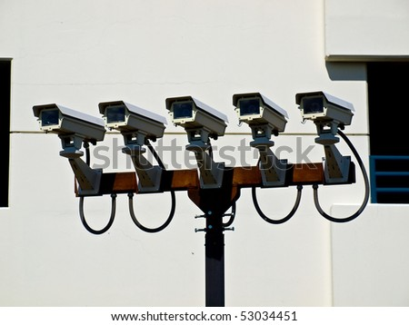 Group of Five Security Cameras Performing Surveillance - stock photo