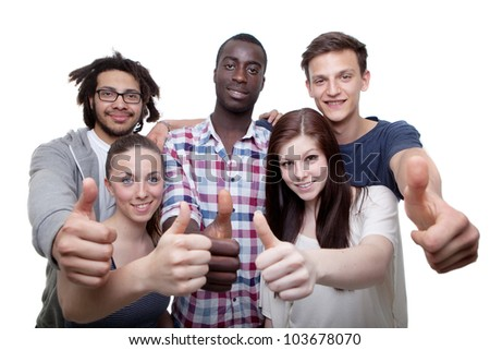Group of five young men and women showing thumbs up sign. - stock photo