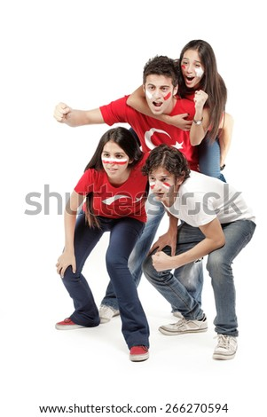 Group of football fans with their faces painted - isolated over white - stock photo