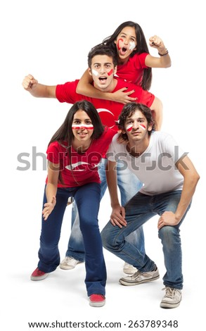 Group of football fans with their faces painted jumping - isolated over white - stock photo