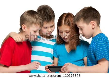 Group of four children are playing with smartphone on the white background