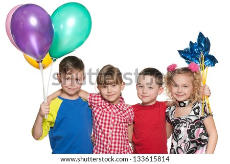 Group of four children celebrate a birthday; on the white background - stock photo