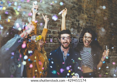 Group of four friends laughing out loud outdoor, sharing good and positive mood. Making party outdoor with champagne and confetti - stock photo