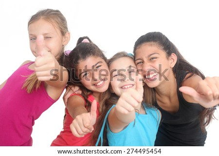 group of four happy kids showing thumbs up on a white background