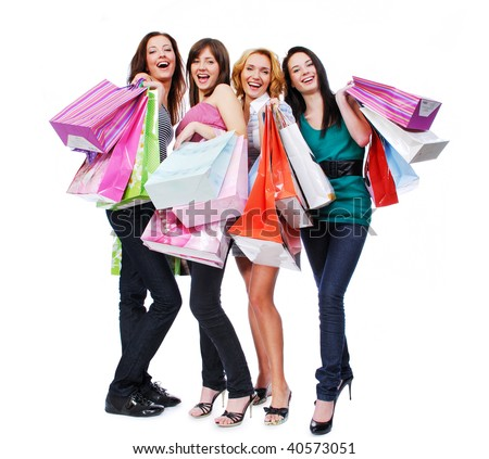 group of four happy young adult women out of shopping with colored bags - stock photo