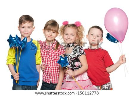 Group of four kids celebrate a birthday - stock photo