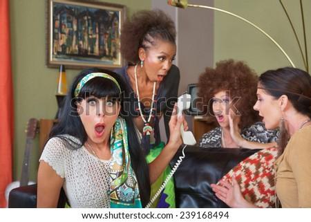 Group of four retro ladies listening to telephone - stock photo