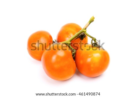 Group of four small tomato isolated on white background