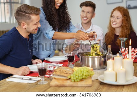 Group of Four Young Friends Having a Dinner Together While Celebrating Something. - stock photo