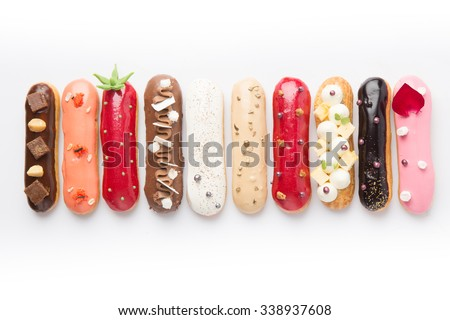 Group of french dessert Eclair on white background - stock photo