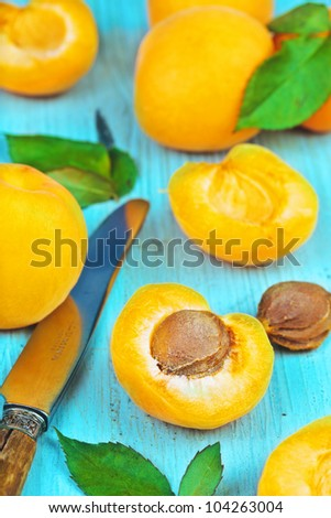 Group of fresh apricots on a table with knife