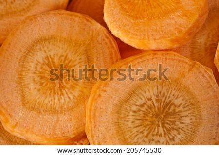 group of Fresh Carrots washers background - stock photo