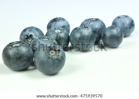 Group of fresh juicy blueberries isolated on white background