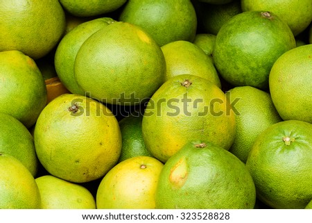 Group of fresh pomelo (Citrus maxima or Citrus grandis) fruits on display at the fruits stall at Bugis Village wet market, Singapore