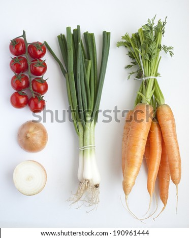 Group of fresh vegetables on a white background - stock photo
