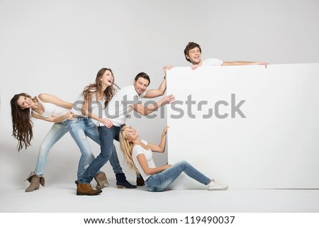 Group of friend holding board