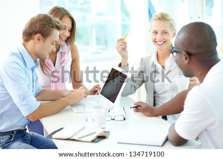 Group of friendly businesspeople having meeting - stock photo