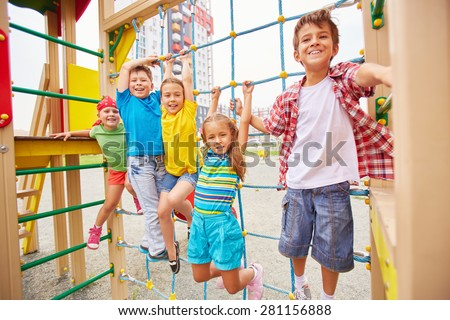 Group of friendly kids having fun outdoors