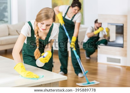 Group of friends as a professional cleaners tiding up big apartment - stock photo