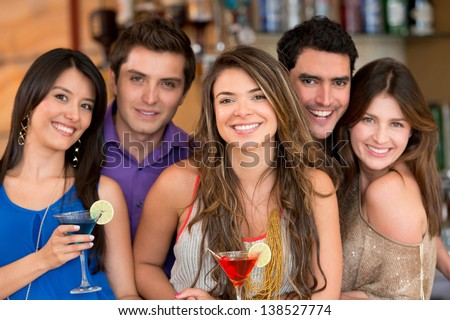 Group of friends at the bar having drinks - stock photo