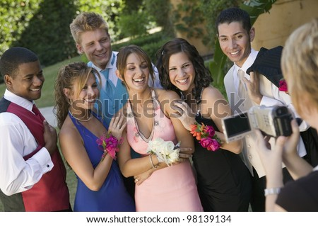 Group of Friends Being Videotaped at School Dance - stock photo