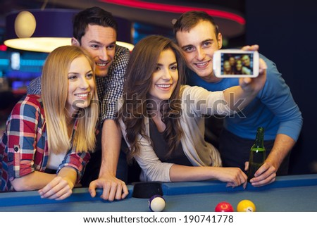 Group of friends catching memories from billiard club - stock photo