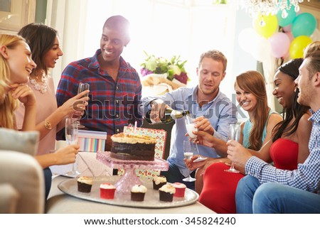 Group Of Friends Celebrating Birthday At Home Together