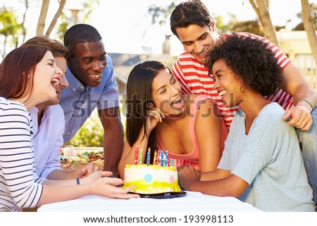 Group Of Friends Celebrating Birthday Outdoors