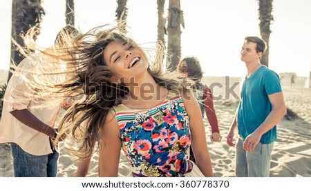 Group of friends celebrating on the beach in LA. Concept about friendship, good mood and people - stock photo