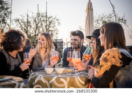 group of friends drinking at cafe - stock photo