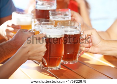 Group of friends drinking beer outdoors