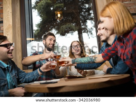 Group of friends drinking in cafe and have fun