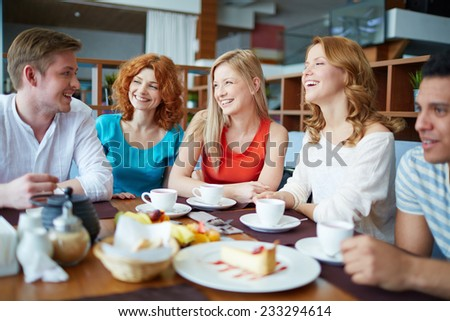 Group of friends drinking tea at caf���© - stock photo