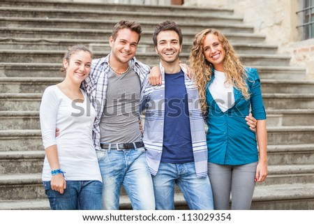 Group of Friends Embraced - stock photo