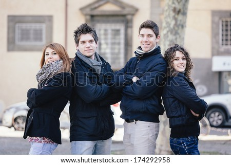 Group of Friends Embraced Outdoor - stock photo