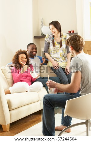 Group Of  Friends Enjoying Chinese Takeaway Meal At Home - stock photo