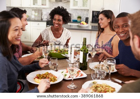 Group Of Friends Enjoying Dinner Party At Home - stock photo