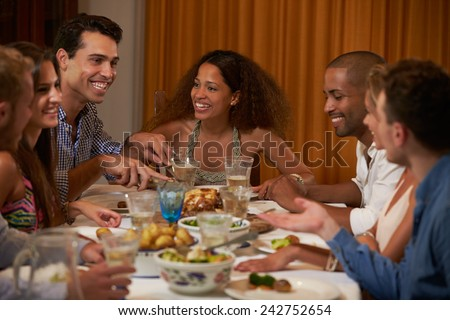 Group Of Friends Enjoying Dinner Party At Home Together - stock photo