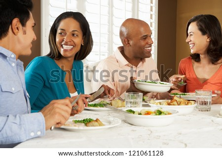 Group Of Friends Enjoying Meal At Home - stock photo
