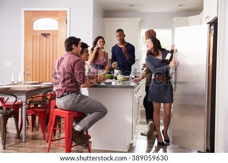 Group Of Friends Enjoying Pre Dinner Drinks At Home - stock photo
