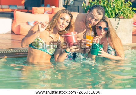 group of friends enjoying the afternoon party in the lounge swimming pool. concept about entertainment,party, disco, swimming pool, vacation, and people.