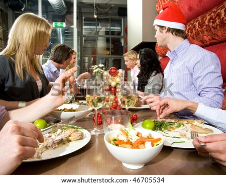Group of friends enjoying their christmas dinner in a restaurant