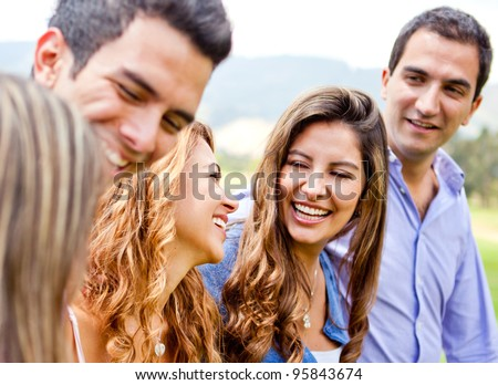 Group of friends hanging out outdoors having fun - stock photo