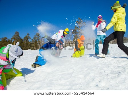 group of friends have a snowball fight