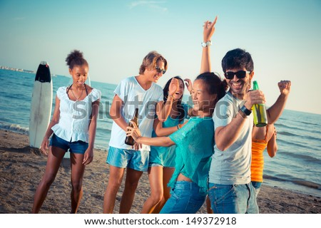 Group of Friends Having a Party at Beach