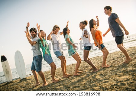 Group of Friends Having a Party on the Beach,Italy - stock photo