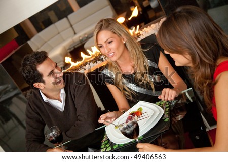 Group of friends having dinner at a restaurant - stock photo