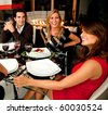 Group of friends having dinner in a nice restaurant - stock photo